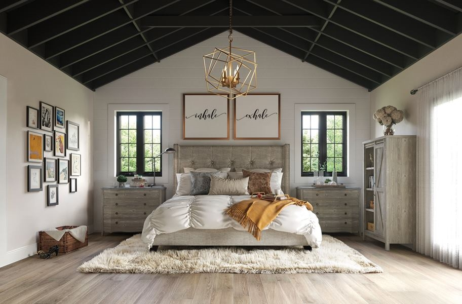 bedroom scene with porcelain tile and rug