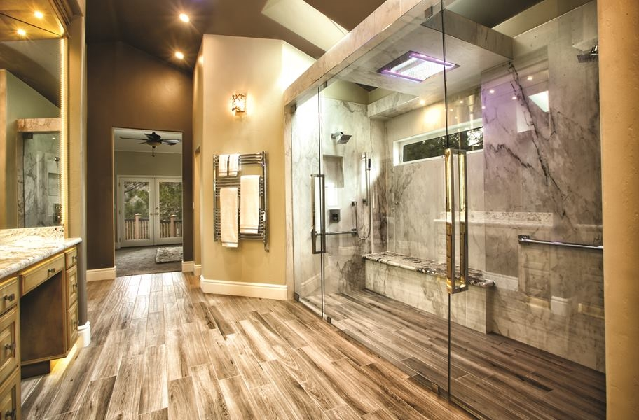 bathroom and shower with wood look tile