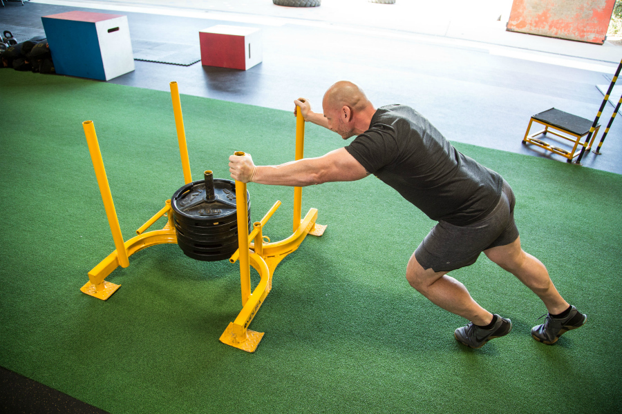 Gym and sports turf buying guide: launch turf rolls in a sled pull area