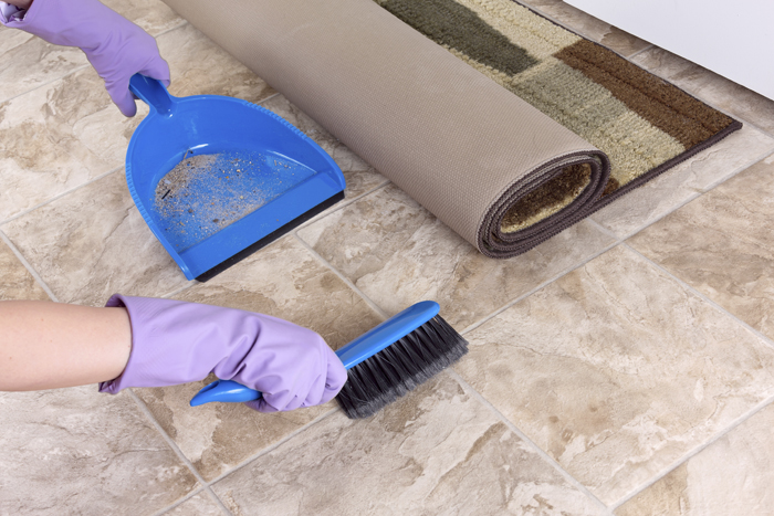 Flooring Inc. Tile Cleaning Guide: sweeping tile with a broom and dustpan
