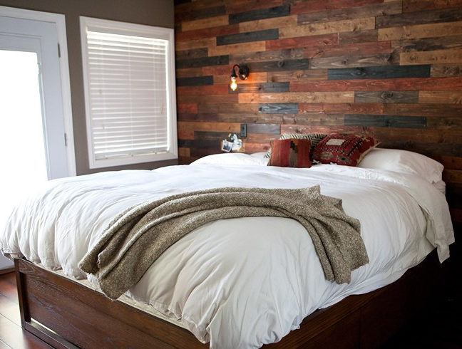 bedroom with repurposed flooring on the wall