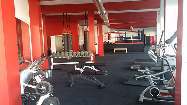 Photo Friday: Powerhouse Kickboxing. A powerhouse kickboxing studio designed with tumbling mats for safety and cushion