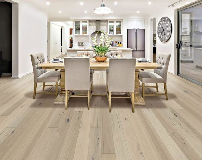 Engineered hardwood planks in a kitchen and dining room