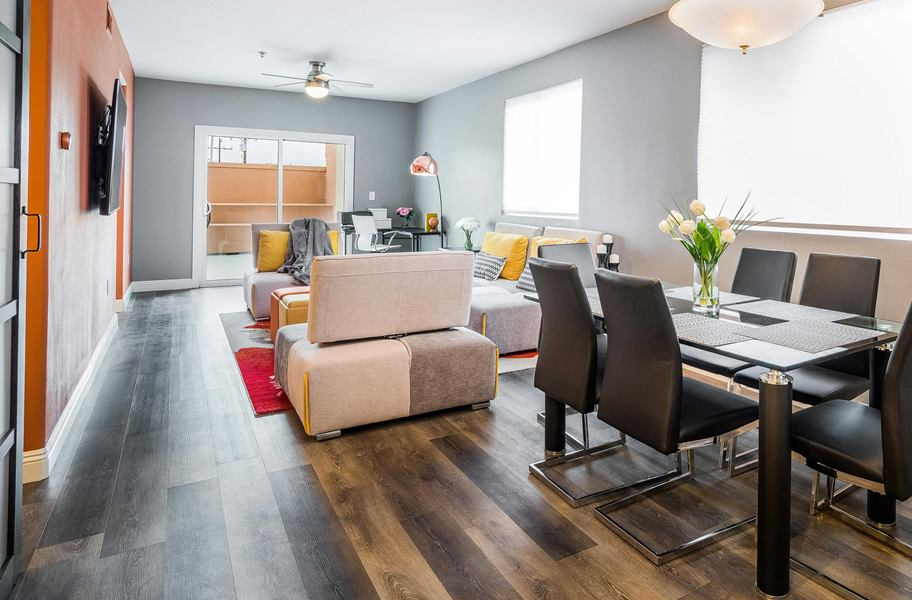 Flooring Inc Laminate vs Vinyl Flooring: TritonCORE waterproof vinyl flooring in living room setting