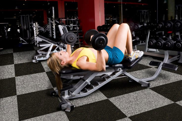 Woman working out on bench