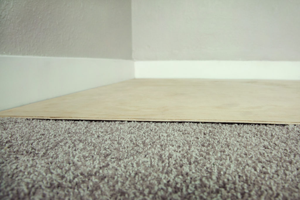 Plywood over carpet