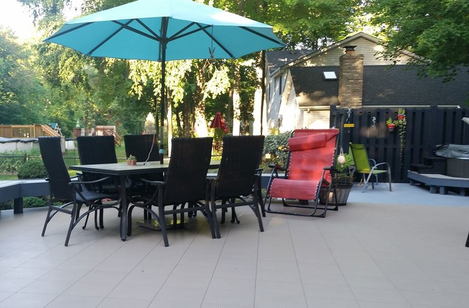 plastic deck tiles in a back yard setting