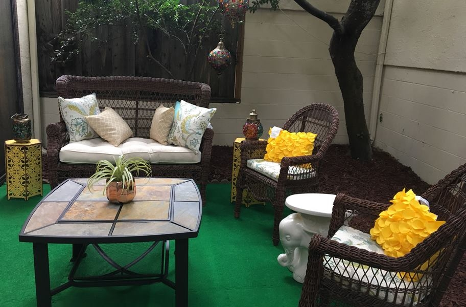 Soft foam tiles with a turf top in an outdoor patio