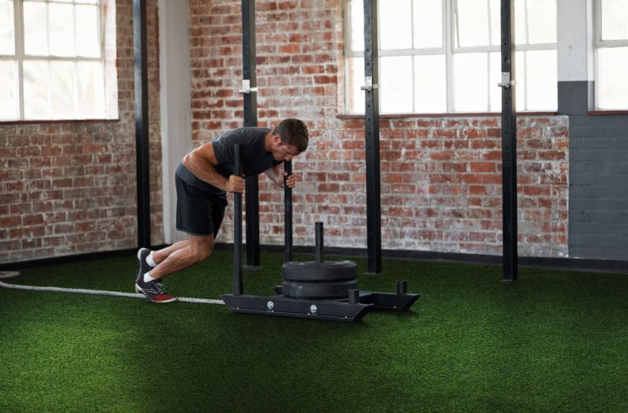 Durable gym turf in a home gym setting