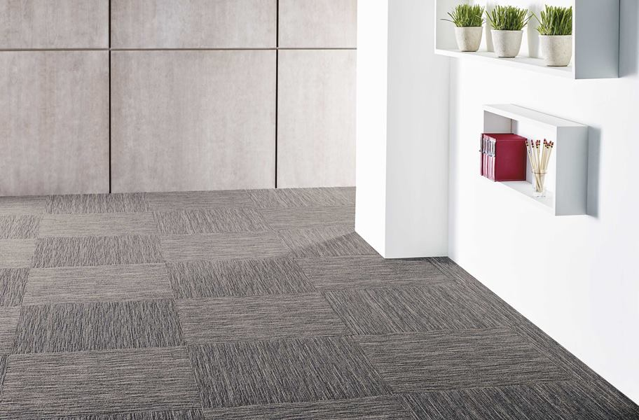 Gray carpet squares in a commercial setting