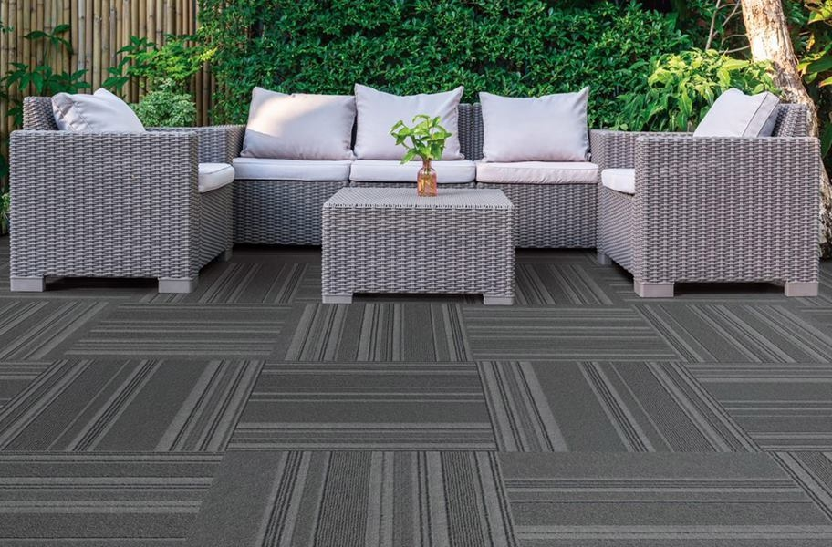 Water-resistant outdoor carpet tiles