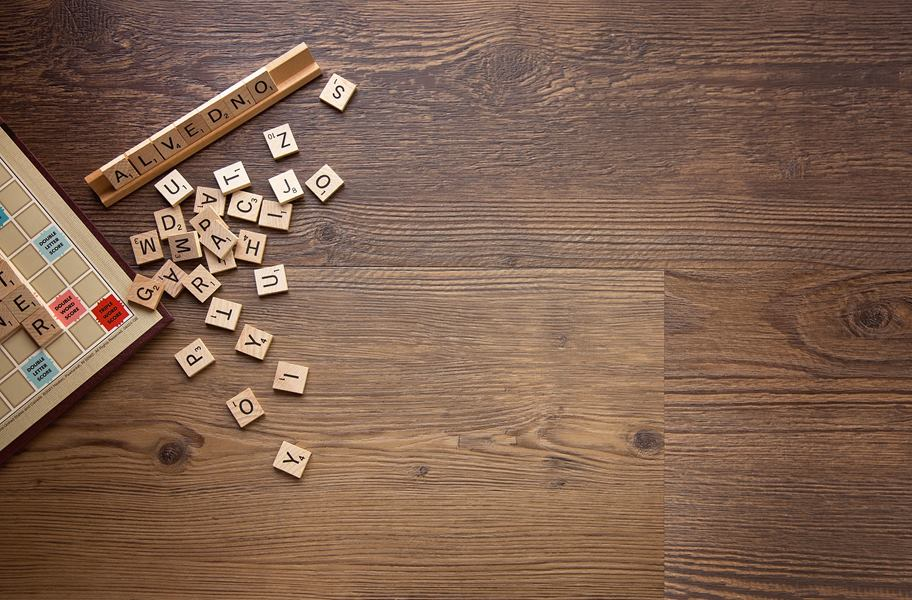 brown waterproof vinyl flooring with scrabble tiles