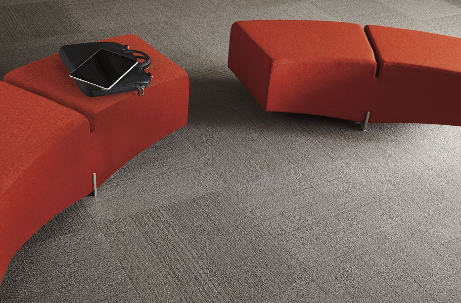 grey carpet tile with red benches
