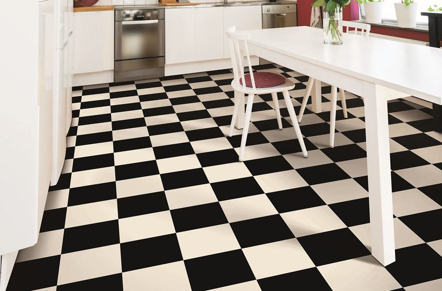 checkered vinyl sheet flooring in white kitchen