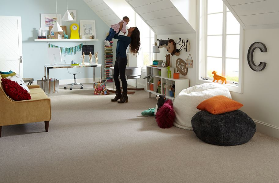 room scene with mother and child on neutral carpet