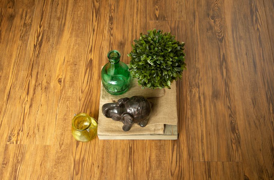 golden waterproof vinyl flooring with plant, vases, and figurine