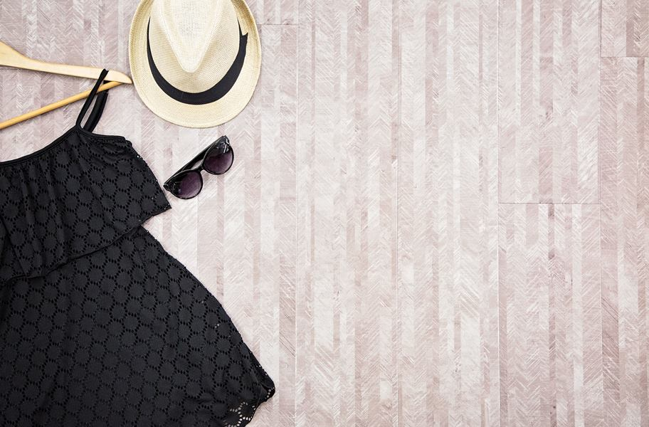 vinyl plank flooring with hat, black dress, and sunglasses