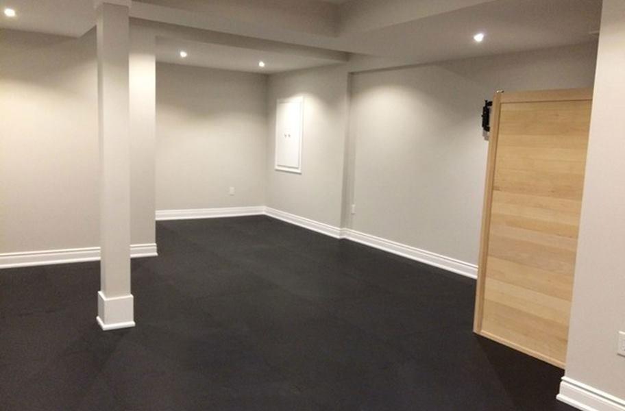 Interlocking rubber floor tiles in a basement setting