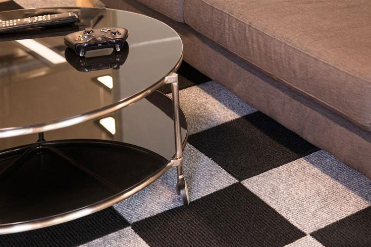 basement flooring with table and couch
