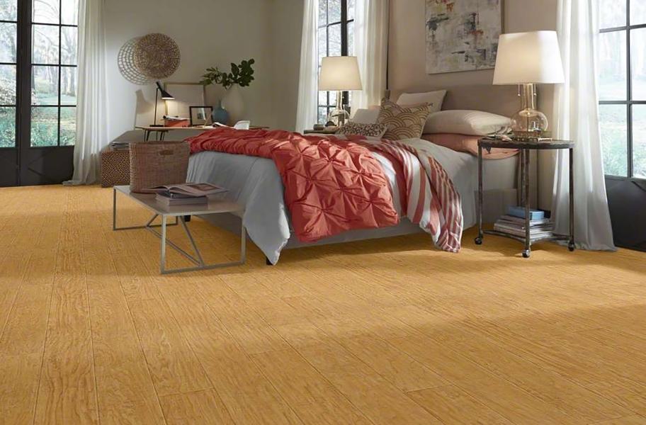 FlooringInc Vinyl Sheet Buying Guide: wood-look sheet vinyl in a bedroom