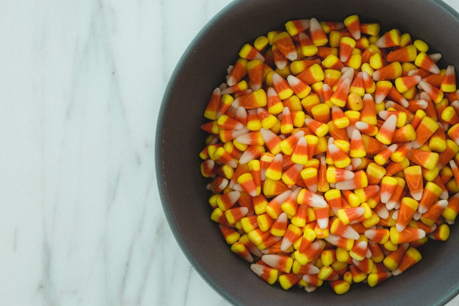 Halloween garage trick-or-treating area with bowl of candy corn