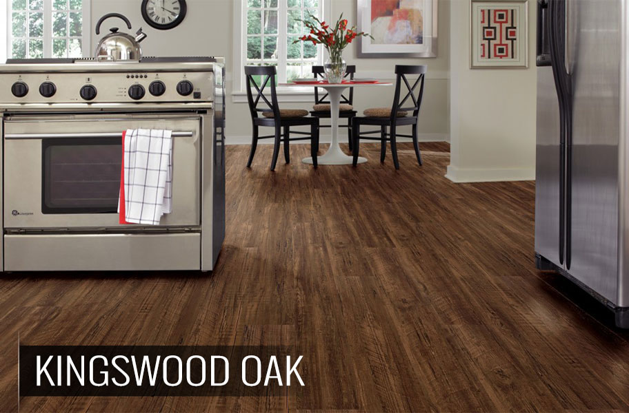 Dark wood-look vinyl flooring planks in kitchen