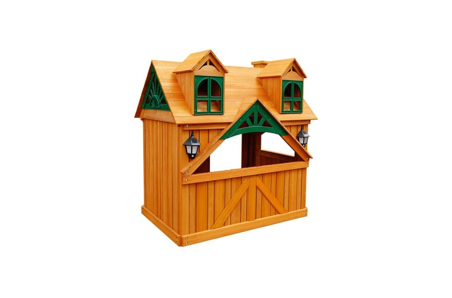 A deluxe wooden outdoor fort or playhouse for the back yard.