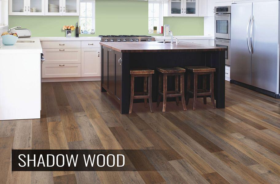 High variation wood-look vinyl plank flooring in modern kitchen