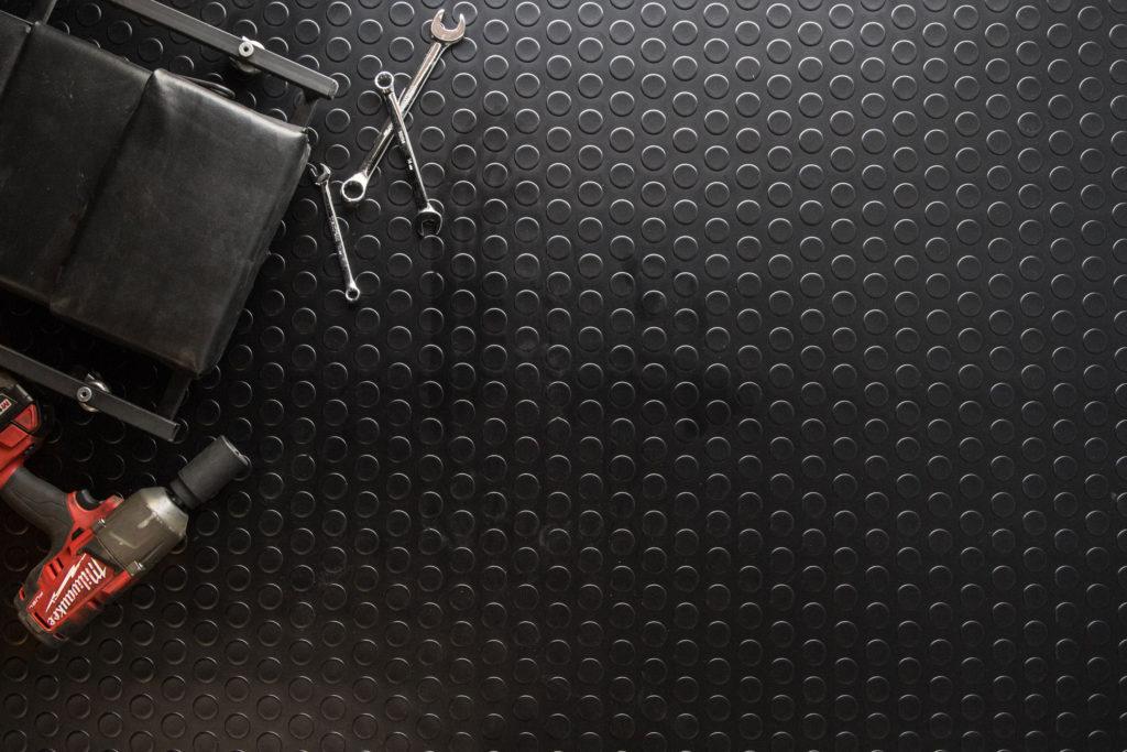 FlooringInc Coin Nitro Rolls with tools as trailer flooring
