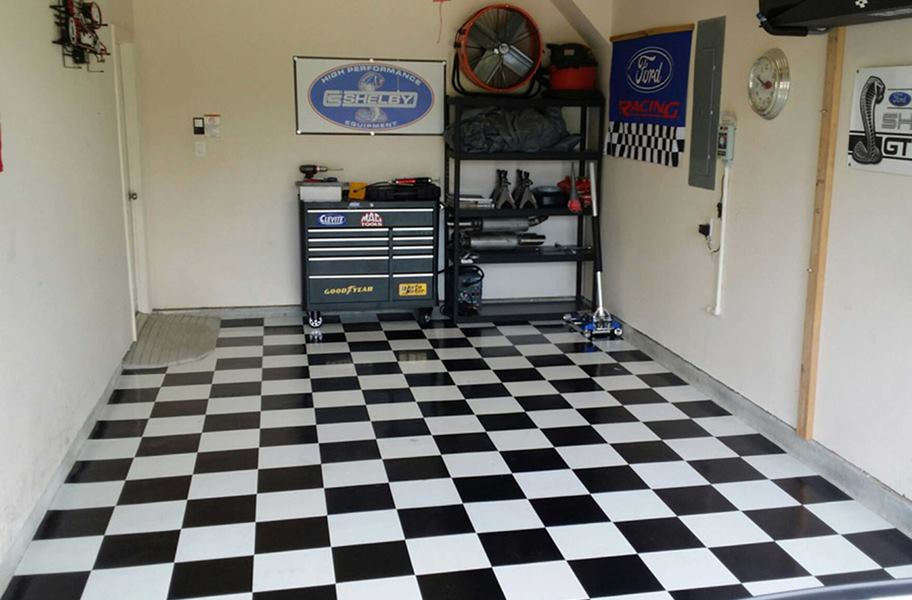Black and white checkered peel & stick vinyl floor tiles in garage