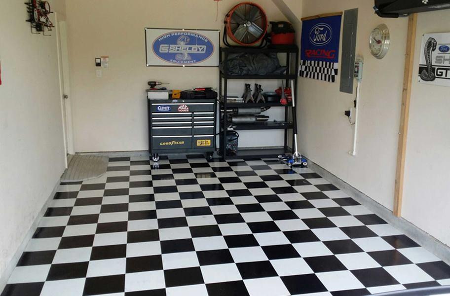 Black and white checkered peel & stick vinyl floor tiles in garage