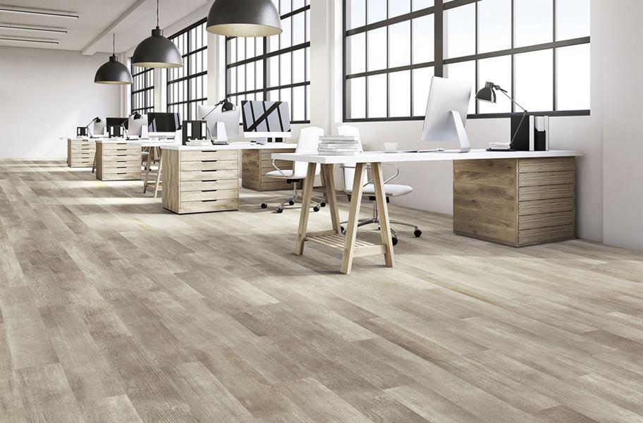 Luxury vinyl plank flooring in modern, open office space