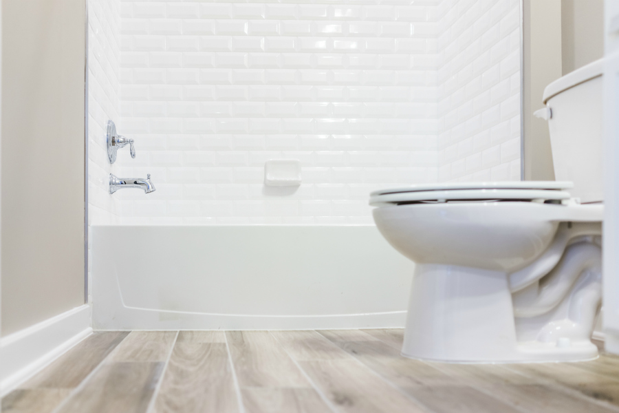 Beachy white washed wood-look bathroom flooring