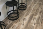 Mega Click Laminate Flooring by Flooring Inc with two stools