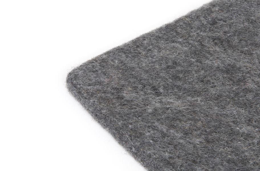 Recycled fiber carpet cushion