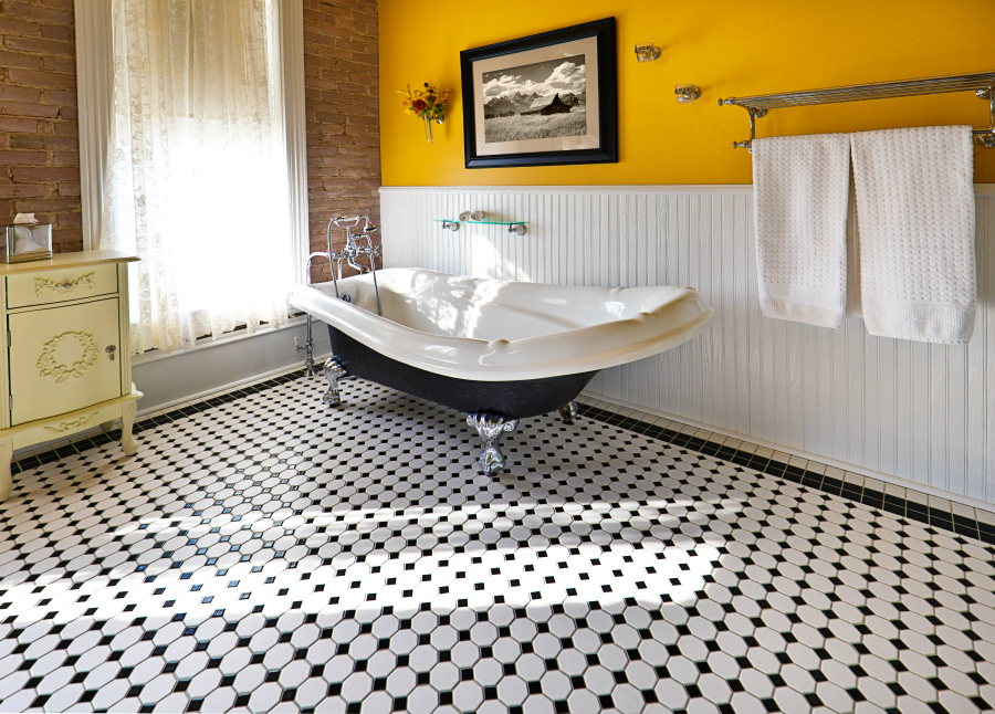 Black and white tile flooring in a bathroom setting