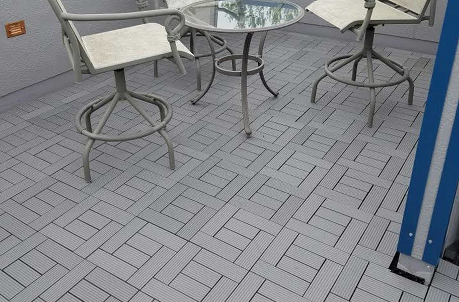 Helios Deck Tiles in outdoor setting with table and chairs