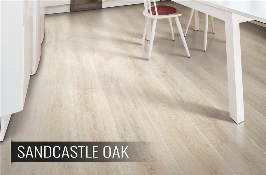 Whitewashed laminate flooring in kitchen setting - FlooringInc