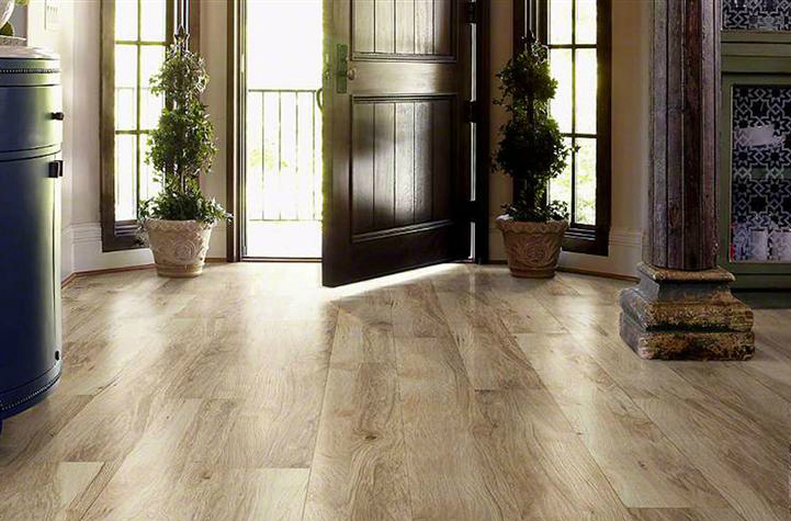 Shaw distressed blonde laminate flooring in a residential setting