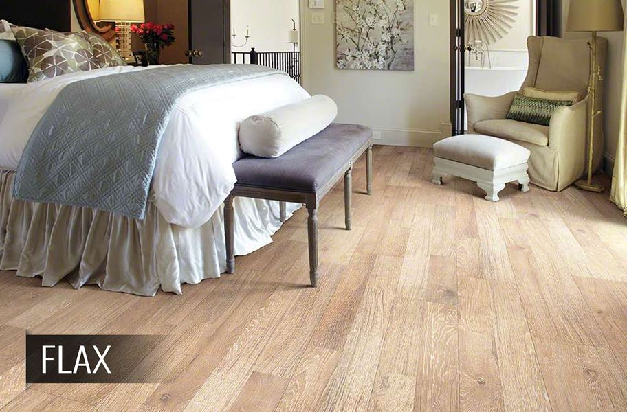 Shaw reclaimed wood-look laminate flooring in a bedroom setting
