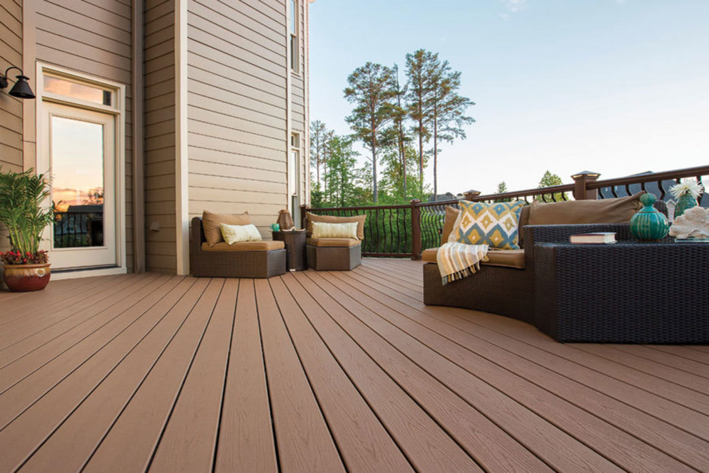 Smooth wood-look flooring in a residential composite deck setup