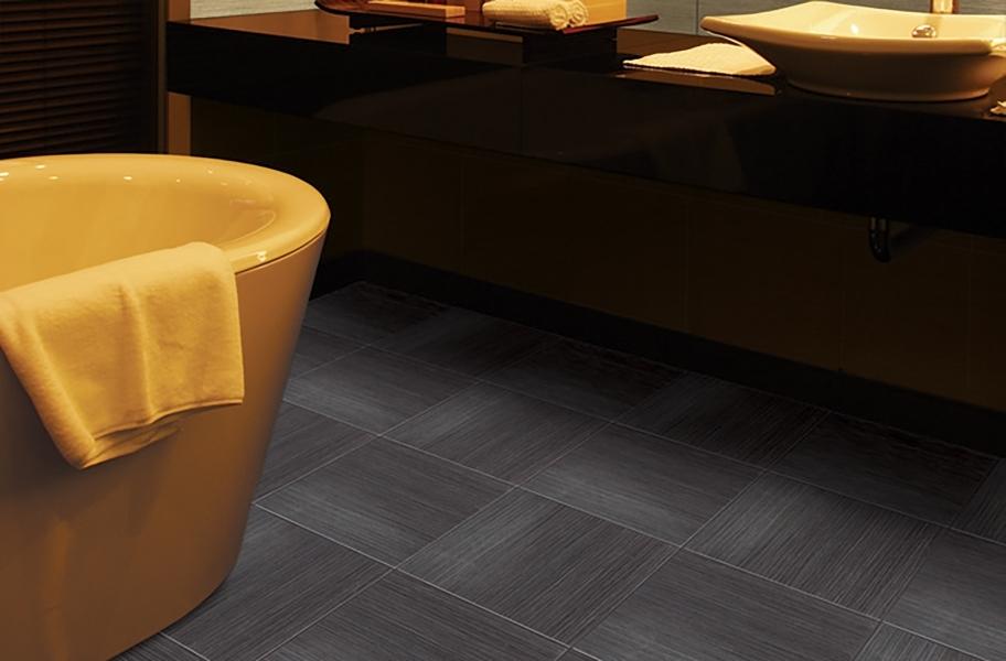 gray tile flooring in a bathroom setting