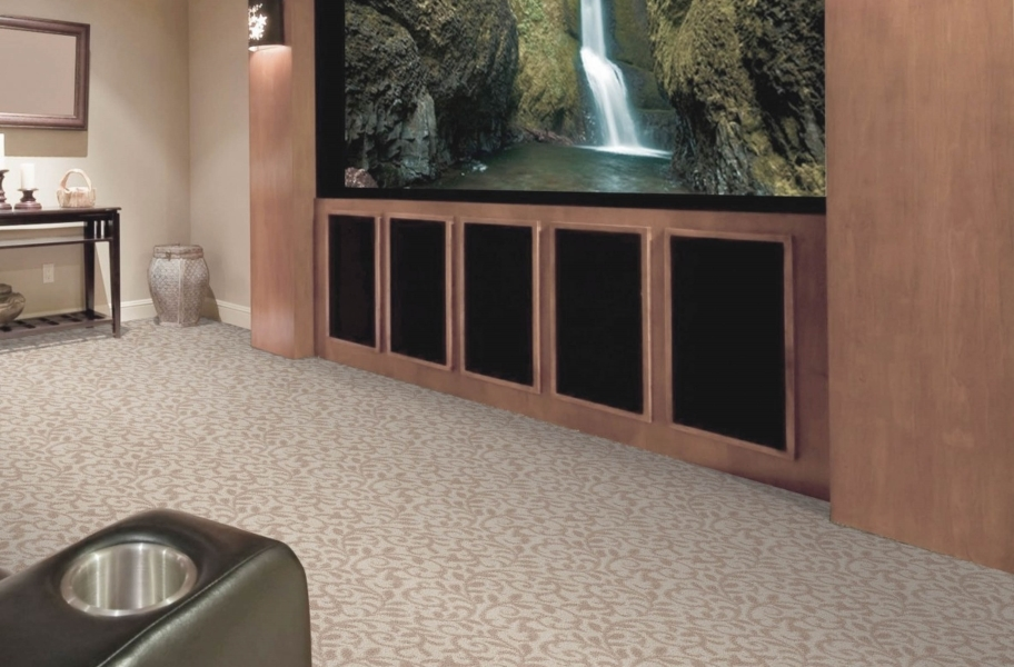 FlooringInc 2020 carpet trends: neutral floral carpet in a home theater setting