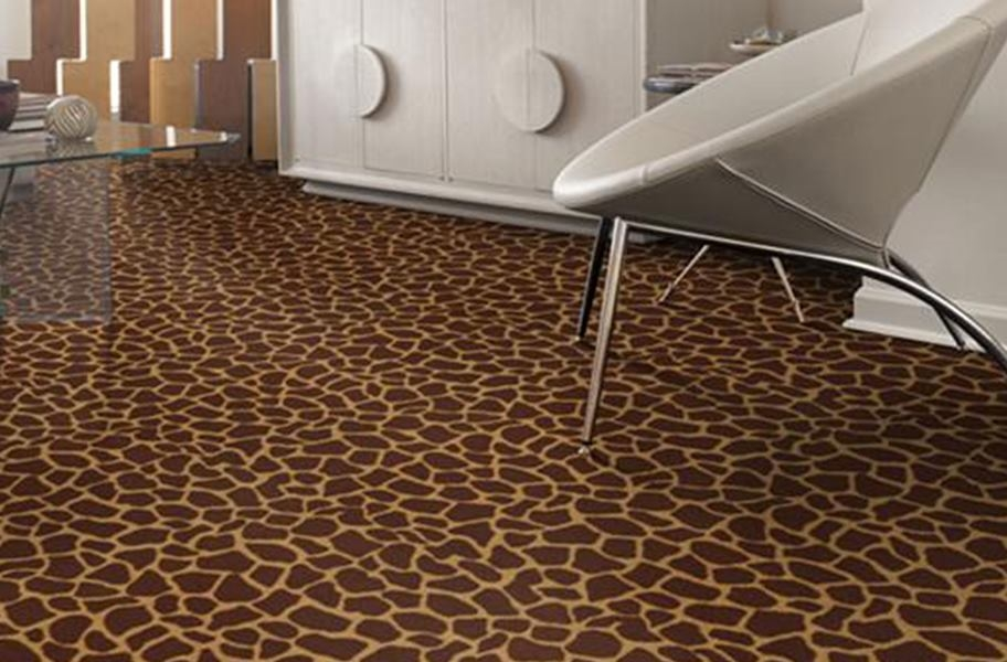 FlooringInc 2020 carpet trends: giraffe print carpet in a living room setting