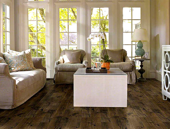 FlooringInc Waterproof Laminate in a living room setup