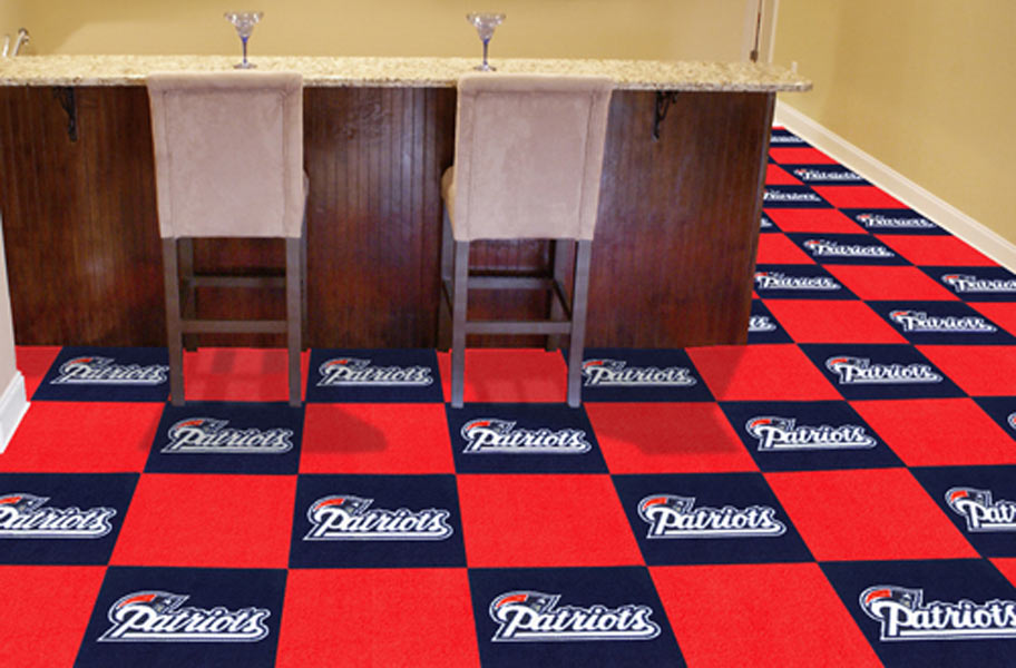 FlooringInc Fanmats NFL Carpet Tiles in a basement setting with a bar