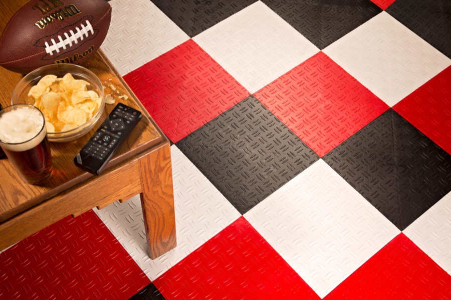 FlooringInc Nitro Tiles in a garage floor with football and snacks