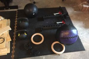 FlooringInc Shock Mats in home garage gym setting