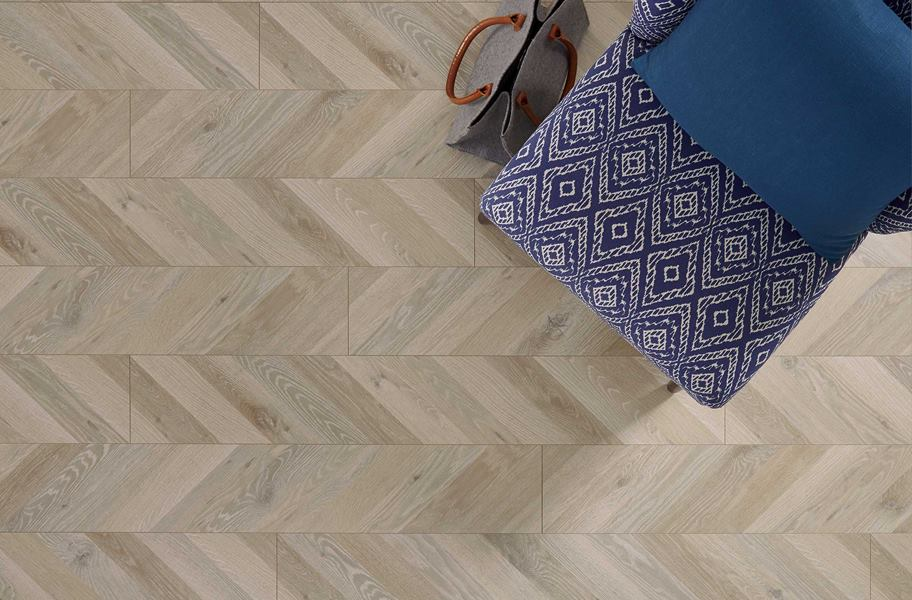 above shot of waterproof laminate in a parquet style. Blue graphic chair and purse.