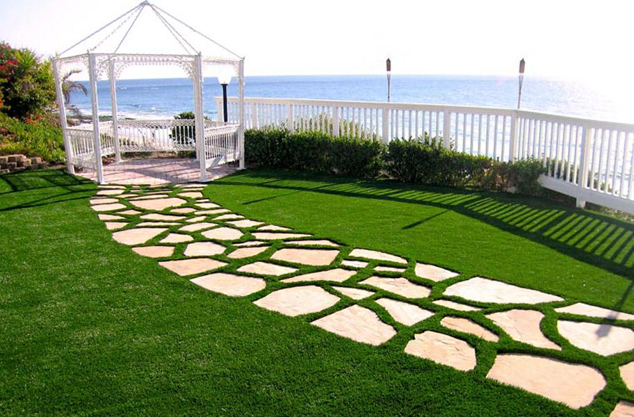 artificial grass lawn with stone pavers